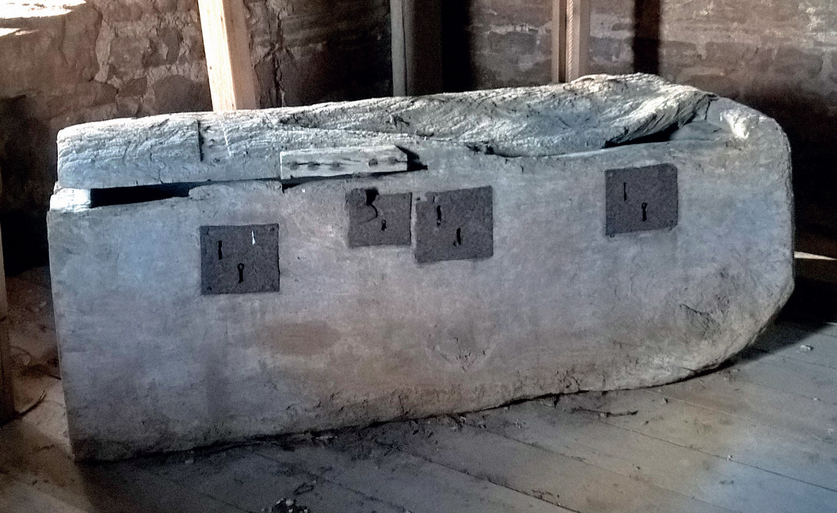 The 13th century dug-out chest in the belfry at St Mary's Church, Foy, Herefordshire