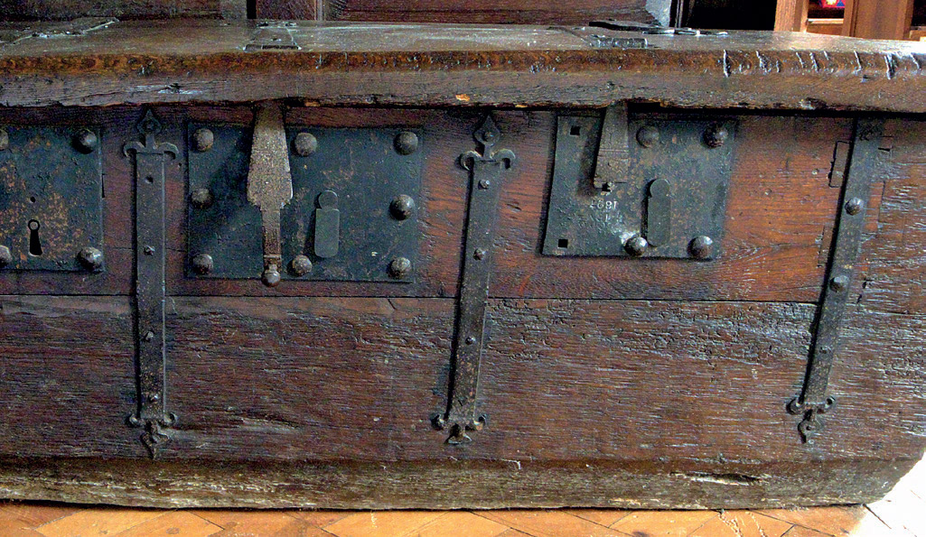 The dug-out chest at St John the Baptist, Feckenham, Worcestershire, showing cut-in oak patch repairs behind 19th century replacement locks