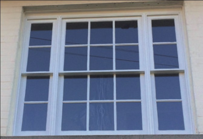 A replication of original sash windows, using a fine timber double-glazed replacement.