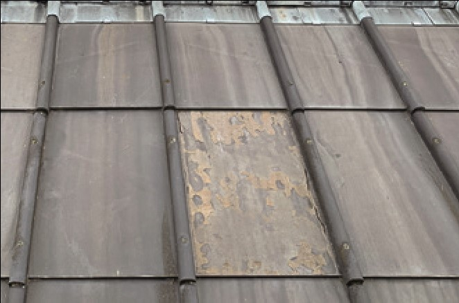 A close-up of older and newer slates on the repaired roof