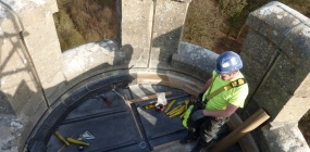 A conservator prepares to abseil down King Alfred's Tower, Somerset (Photo: Helen Martin, St Ann's Gate Architects)